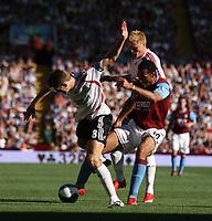 Photo: Mark Stephenson. <br /> Aston Villa v Liverpool. Barclays Premiership. 11/08/2007. <br /> Liverpool's Steven Gerrard (L) gets the better of Villa's Andriy Voronin