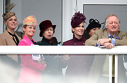 Dolly Maude (second left), The Princess Royal, Zara Tindall and Andrew Parker Bowles watch the race action during Ladies Day of the 2019 Cheltenham Festival at Cheltenham Racecourse.