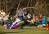 Newfound's Cody McGee reaches in to score for the Bears ahead of the tackle by IL/MA's Chase Harper on Saturday afternoon at Newfound.  (Karen Bobotas/for the Laconia Daily Sun)