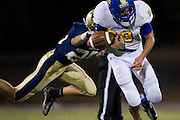 Jonny Klein (80) of the Dallas Lutheran Lions has the ball stripped by Connor Harbor (25) of the McKinney Christian Academy Mustangs at McKinney North High School in McKinney on Friday, September 13, 2013. (Cooper Neill/Special Contributor)