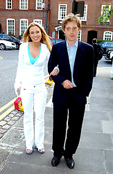 The HON.IMOGEN LLOYD WEBBER and her brother the HON.NICK LLOYD WEBBER childrenr of Andrew Lloyd Webber, at Sir David & Lady Carina Frost's annual summer party held in Carlyle Square, London on 6th July 2004.