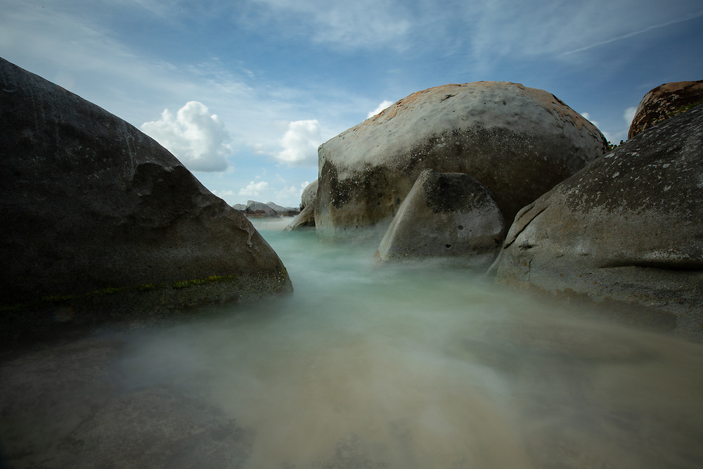 Warm Carribean waves reaching the boulder lined shores at The Baths on Virgin Gorda.