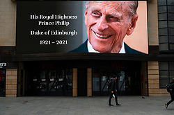 © Licensed to London News Pictures. 09/04/2021. LONDON, UK. A digital screen in Leicester Square displays a tribute to Prince Philip, aged 99, whose death was announced by Buckingham Palace.  Photo credit: Stephen Chung/LNP