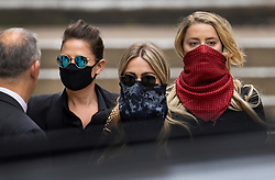 © Licensed to London News Pictures. 07/07/2020. London, UK. US actor Amber Heard (R)  and  Bianca Butti (L) leave The High Court in Central London. Johnny Depp's libel trial against The Sun newspaper is due to take place over the next three weeks over allegations he was violent and abusive towards his ex-wife Amber Heard. Photo credit: Peter Macdiarmid/LNP