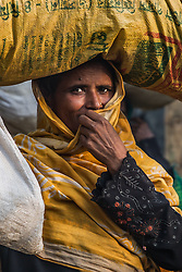 February 6, 2018 - Cox's Bazar, Bangladesh - A Rohingya woman covers her face in the Kutupalong refugee camp in Cox's Bazar. More than 800,000 Rohingya refugees have fled from Myanmar Rakhine state since August 2017, as most of them keep trying to cross the border to reach Bangladesh every day. (Credit Image: © Marcus Valance/SOPA via ZUMA Wire)
