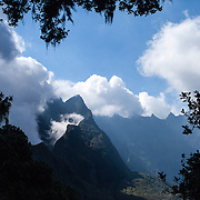 Clouds form around the mountains on the hike to Col du Taibit