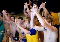 Players of Koper and coach Marino Cetin celebrate at last final game of Slovenian Waterpolo National Championship between ASD Rokava Koper and VK Triglav Kranj, on June 6, 2009, in Zusterna, Koper, Slovenia. Rokava Koper won 13:6 and became Slovenian National Champion for the season 2008/2009. (Photo by Vid Ponikvar / Sportida)
