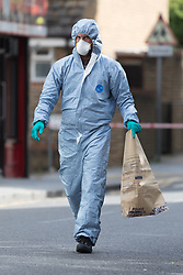 © Licensed to London News Pictures. 10/09/2018. London, UK.  Police forensic officers at the scene in Anglesea Road, Woolwich where a woman was stabbed multiple times in her back at around 9:30am this morning.  Photo credit: Vickie Flores/LNP