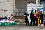 Emergency service personnel stand near essential supplies waiting to be distributed to the residents of the Sutton Street housing complex amid the third full day of the total lockdown of 9 housing commission high rise towers in North Melbourne and Flemington during COVID 19.After recording 191 COVID-19 cases overnight forcing Premier Daniel Andrews to announce today that all of metropolitan Melbourne along with one regional centre, Mitchell Shire will once more go back to stage three lockdowns from midnight Wednesday June 8. This comes as the residents of the housing commission towers in North Melbourne and Flemington finish their third day under extreme lockdown, despite only 27 cases being found in the towers. Members of the public gathered outside of the towers this afternoon in support of those trapped inside while riot police arrested two women for standing too close to the fence. While the women were later released, tensions are boiling over both in the towers and out. With 772 active cases in Victoria, NSW closed their border to Victoria effective at midnight tonight.