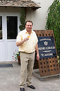 Claude Giraud, owner and winemaker, tasting a glass of his wine in the court yard in front of his house Champagne house Maison Giraud-Hemart, also called Champagne Henri Giraud, Ay, Vallée de la Marne, Champagne, Marne, Ardennes, France