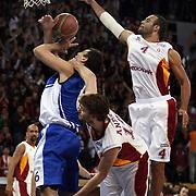 Galatasaray's Joshua Ian Shipp (R) during their BEKO Basketball League match Galatasaray between Turk Telekom at the Abdi Ipekci Arena in Istanbul at Turkey on Sunday, December 25 2011. Photo by TURKPIX