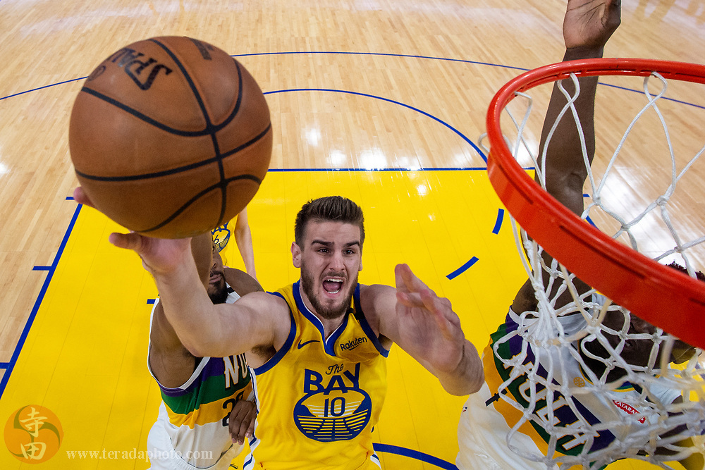 February 23, 2020; San Francisco, California, USA; Golden State Warriors center Dragan Bender (10) shoots the basketball during the first half against the New Orleans Pelicans at Chase Center.