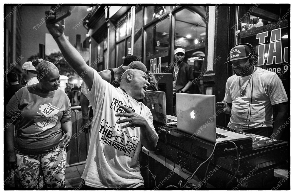 NEWARK, NEW JERSEY:  DJ Duce Martinez grabs a selfie with Midi during the weekly Block Party on Edison Plaice in Newark, NJ on Friday, July 9,1 202 (Brian B Price/TheFotodesk).
