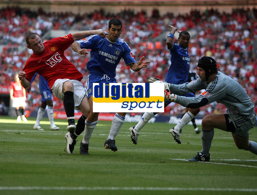 Photo: Rich Eaton.<br /> <br /> Manchester United v Chelsea. FA Community Shield. 05/08/2007. Man United's Wayne Rooney (l) goes in hard on Chelsea goalkeeper Petr Cech watched by Tal Ben Haim (c)and receives a yellow card.