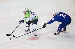David Rodman of Slovenia vs Jonathan Janil of France during the 2017 IIHF Men's World Championship group B Ice hockey match between National Teams of France and Slovenia, on May 15, 2017 in AccorHotels Arena in Paris, France. Photo by Vid Ponikvar / Sportida