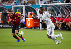July 31, 2018 - Miami Gardens, Florida, USA - Manchester United F.C. midfielder Juan Mata (8) (left) and Real Madrid C.F. forward Vinicius Junior (28) (right) chase a ball during an International Champions Cup match between Real Madrid C.F. and Manchester United F.C. at the Hard Rock Stadium in Miami Gardens, Florida. Manchester United F.C. won the game 2-1. (Credit Image: © Mario Houben via ZUMA Wire)