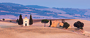 Chapel, Chiesetta di Vitaleta, and typical Tuscan homestead at San Quirico D'Orcia near Pienza  in Val D'Orcia, Tuscany, Italy RESERVED USE<br /> FINE ART PHOTOGRAPHY by Tim Graham