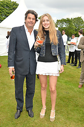 TIM MOUFARRIGE and his daughter NATASHA MOUFARRIGE at the Cartier Queen's Cup Polo final at Guard's Polo Club, Smiths Lawn, Windsor Great Park, Egham, Surrey on 14th June 2015
