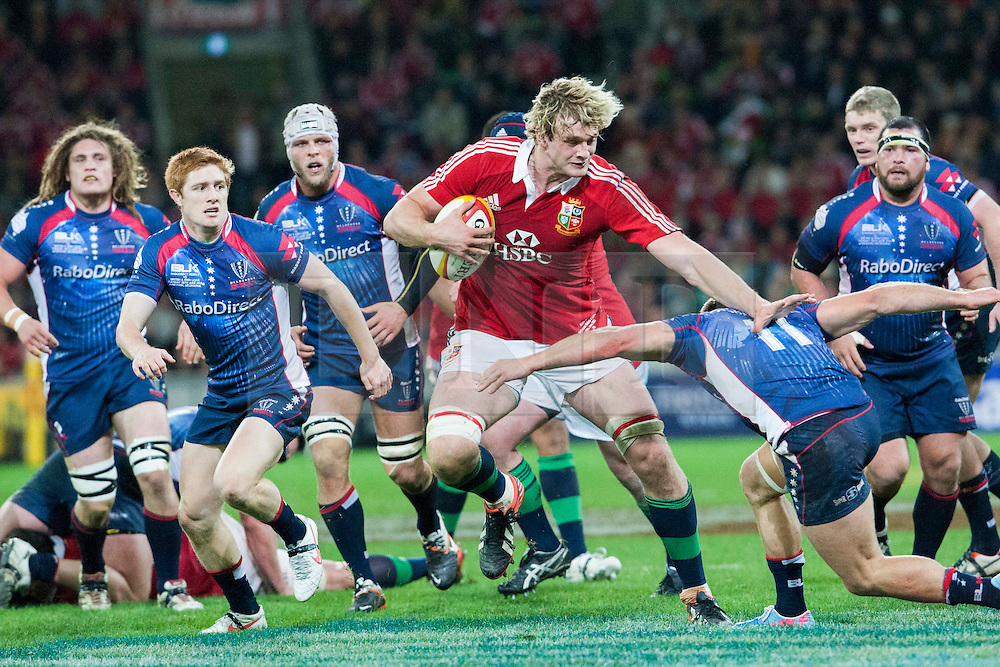© Licensed to London News Pictures. 25/6/2013. Richie Gray charges through the pack during the British & irish Lions tour match between Melbourne Rebels Vs British & Irish Lions at AAMI Park, Melbourne, Australia. Photo credit : Asanka Brendon Ratnayake/LNP