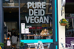 Glasgow, Scotland, UK. 26 October 2020. View of Glasgow city centre on weekday during circuit breaker lockdown with bars and restaurants closed. Pictured; Pure Deid Vegan cafe  . Iain Masterton/Alamy Live News