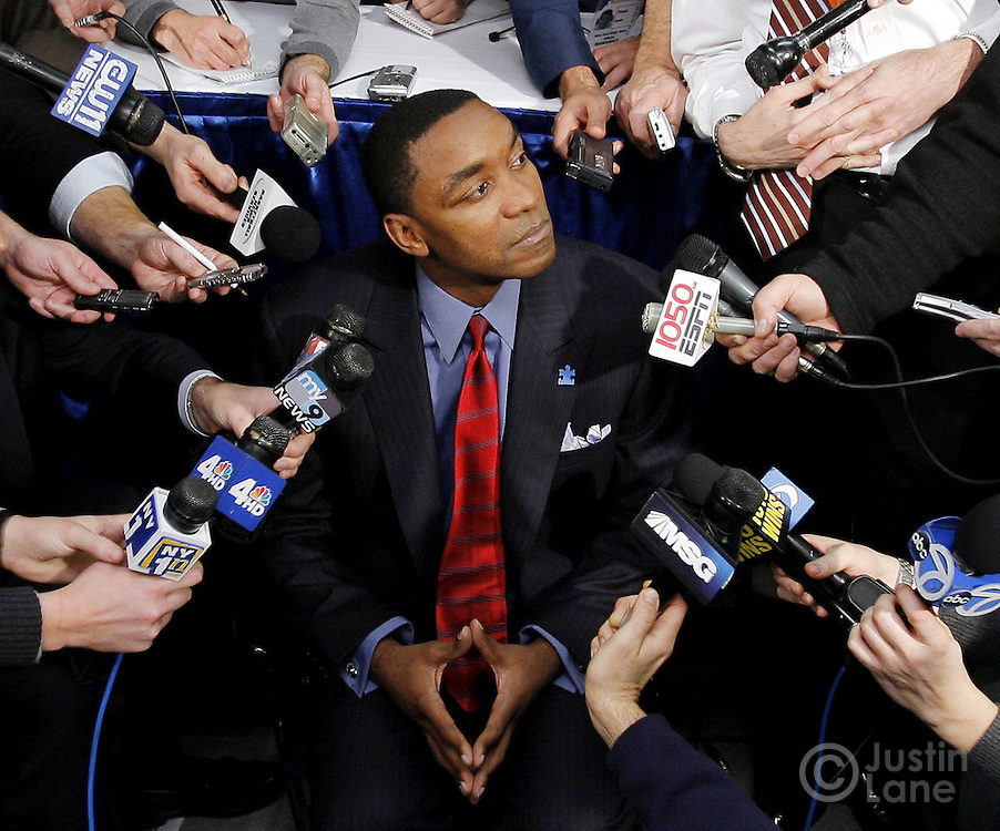 New York Knicks head coach Isiah Thomas talks to a crowd of reporters at Madison Square Garden in New York, New York on Monday 18 December 2006.