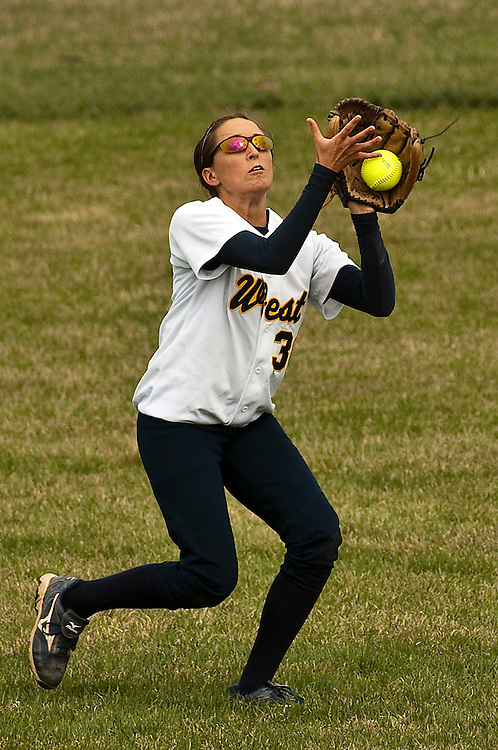 Matt Dixon | The Flint Journal..Lapeer West's Shannon Miller attempts to catch a fly ball in right field during a softball game against Flushing High School at Lapeer West High School Thursday afternoon. Flushing defeated Lapeer West 10-3 in the first game of a doubleheader.