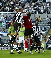 Fotball<br /> England 2005/2006<br /> Foto: SBI/Digitalsport<br /> NORWAY ONLY<br /> <br /> Newcastle United v Deportivo La Coruna<br /> Intertoto Cup.<br /> 03/08/2005.<br /> Newcastle's Alan Shearer (L) clatters into the Deportivo goalkeeper, Jose Molina (R).