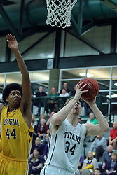 21 February 2017:  Tyler Burdine gets inside of Micah Martin during an College men's division 3 CCIW basketball game between the Augustana Vikings and the Illinois Wesleyan Titans in Shirk Center, Bloomington IL
