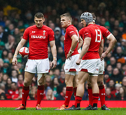 Dan Biggar of Wales with with team-mate Gareth Anscombe<br /> <br /> Photographer Simon King/Replay Images<br /> <br /> Six Nations Round 5 - Wales v Ireland - Saturday 16th March 2019 - Principality Stadium - Cardiff<br /> <br /> World Copyright © Replay Images . All rights reserved. info@replayimages.co.uk - http://replayimages.co.uk
