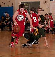 Lou Athanas/Laconia's Bryce McCrea dribbles past Gilmanton's Isaac Dandurand during the Junior Coed division final championship game at the 19th annual Francoeur/Babcock Basketball Tournament held Sunday morning at Gilford Middle School.   (Karen Bobotas/for the Laconia Daily Sun)