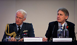 © Licensed to London News Pictures. 01/11/2012. London, UK. Philip Hammond, Secretary of State for Defence (R), and Air Chief Marshal Sir Stephen Dalton are seen during a question and answers session at the Chief of the Air Staff's Air Power Conference 2012 held by the Royal United Services Institute (RUSI) in Westminster, London, today (01/11/12). Photo credit: Matt Cetti-Roberts/LNP
