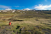 Tourist watches the Mountainlandscape if the Snaefellsjökull National Park. Iceland.