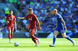Aron Gunnarsson of Cardiff City chases down Roberto Firmino of Liverpool- Mandatory by-line: Nizaam Jones/JMP - 21/04/2019 -  FOOTBALL - Cardiff City Stadium - Cardiff, Wales -  Cardiff City v Liverpool - Premier League