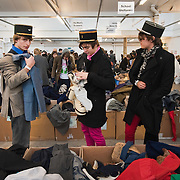 LONDON, ENGLAND - FEBRUARY 06:  Three young men choose outfits at Angels Retro Sale on February 6, 2010 in London, England. Angels Costumiers are selling over 25,000 items of clothing and accessories from their warehouse in Wembley on February 6, 2010. The Retro Sale features fashion items from the 1950s to the 1990s as well as period military uniforms. Angels is the world's longest-established supplier of costumes to film and theatre, founded in 1840 the company supplies costumes to over 1000 productions per year.  (Photo by Marco Secchi/Getty Images)