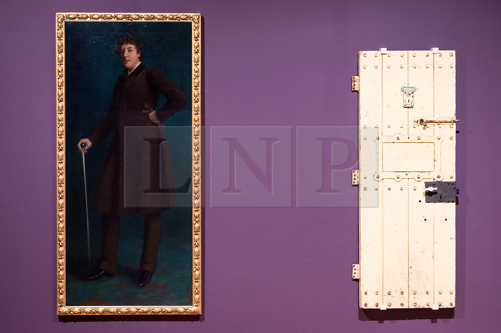 © Licensed to London News Pictures. 03/04/2017. (L to R) Painting of Oscar Wilde by artist Robert Harper and Oscar Wilde's prison door from Reading prison cell showing as part of Tate Britain's Queer British Art exhibition. London, UK. Photo credit: Ray Tang/LNP