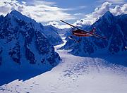 K2 Aviation's Cessna 185 on wheel skis flying above the Ruth Amphitheater, Denali National Park, Alaska.