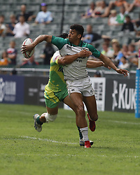 April 6, 2018 - Hong Kong, HONG KONG - Robert Baloucoune (12) of Ireland passes the ball during the 2018 Hong Kong Rugby Sevens at Hong Kong Stadium in Hong Kong. (Credit Image: © David McIntyre via ZUMA Wire)