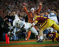 Pasadena, CA -- Texas quarterback Vince Young scores after running over USC  cornerback Josh Pinkard (36) and Scott Ware during the 2006 BCS National Championship game at the Rose Bowl in Pasadena, CA. -- Photo by Jack Gruber, USA TODAY