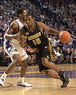 Missouri forward Marshall Brown (R) drives past Kansas State's Cartier Martin (L) during the first half of K-State's 79-64 win over the Tigers at Bramlage Coliseum in Manhattan, Kansas, January 21, 2006.