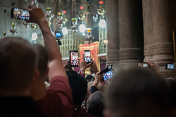 14 April 2019, Jerusalem: Palm People take photos with their phones during Sunday service at the Church of the Holy Sepulchre, in the Old City of Jerusalem.