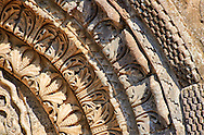 Detail of the archivolts of the  side portal of the Basilica Church of Santa Maria Maggiore, Tuscania .<br /> <br /> Visit our ITALY PHOTO COLLECTION for more   photos of Italy to download or buy as prints https://funkystock.photoshelter.com/gallery-collection/2b-Pictures-Images-of-Italy-Photos-of-Italian-Historic-Landmark-Sites/C0000qxA2zGFjd_k .<br /> <br /> Visit our MEDIEVAL PHOTO COLLECTIONS for more   photos  to download or buy as prints https://funkystock.photoshelter.com/gallery-collection/Medieval-Middle-Ages-Historic-Places-Arcaeological-Sites-Pictures-Images-of/C0000B5ZA54_WD0s