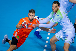 The Dutch handball player Dani Baijens in action against Borut Mackovsek from Slovenia during the European Championship qualifying match on January 6, 2020 in Topsportcentrum Almere