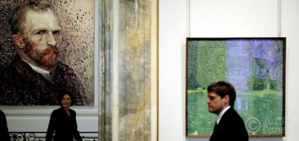 Gustav Klimt's painting 'Pond on Scholss Kammer on the Attersee' is seen at right with large poster of Vincent van Gogh seen at left at an exhibit exploring the influence of Vincent van Gogh on German and Austrian Expressionism at the Neue Galerie in New York, New York on Wednesday 21 March 2007. The exhibit, which features over 80 major paintings, will be open until 02 July 2007.