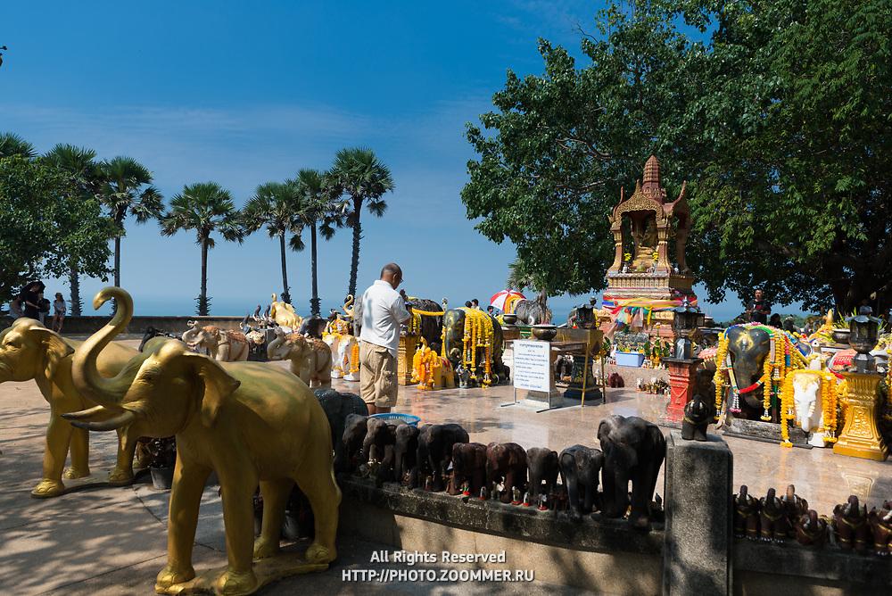 Man praying in the shrine to elephants on Promthep cape, Phuket, Thailand