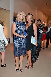 Left to right, GRANIA STEPHENSON and SAMANTHA WICKENS at the Masterpiece Marie Curie Party supported by Jeager-LeCoultre held at the South Grounds of The Royal Hospital Chelsea, London on 30th June 2014.