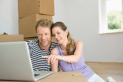 Couple laptop planning new apartment home