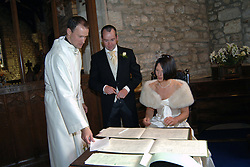 Signing the register; church wedding UK