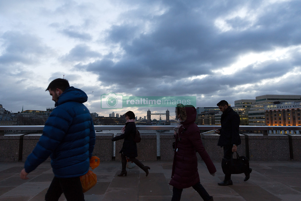 January 3, 2018 - London, London, UK - London, UK. Commuters cross London Bridge during stormy and windy weather, as Storm Eleanor hits London this morning. (Credit Image: © Vickie Flores/London News Pictures via ZUMA Wire)