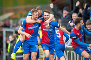 Joe Chalmers (#4) of Inverness Caledonian Thistle FC celebrates with team mates after scoring the opening goal during the William Hill Scottish Cup quarter final match between Dundee United and Inverness CT at Tannadice Park, Dundee, Scotland on 3 March 2019.