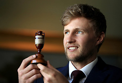 England's Joe Root holds the trophy during the press conference at Lord's, London. PRESS ASSOCIATION Photo. Picture date: Friday October 27, 2017. England depart for Australia on Saturday in preparation for the start of the Ashes Series. PRESS ASSOCIATION Photo. Picture date: Friday October 27, 2017. See PA story CRICKET England. Photo credit should read: Adam Davy/PA Wire. RESTRICTIONS: Editorial use only. No commercial use without prior written consent of the ECB. Still image use only. No moving images to emulate broadcast. No removing or obscuring of sponsor logos.